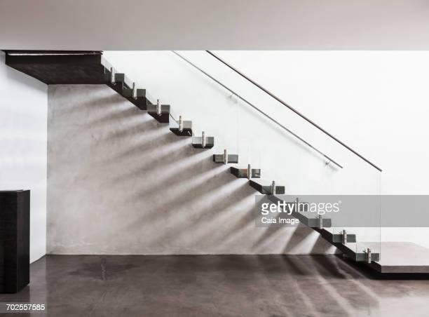 'Modern, minimalist floating staircase in home showcase interior foyer'