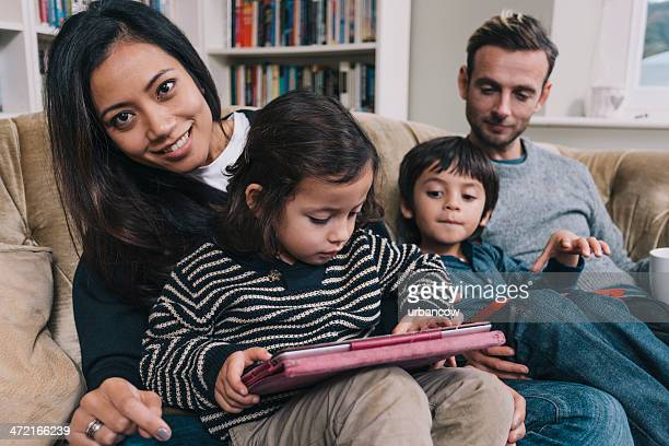 Modern mixed race young family
