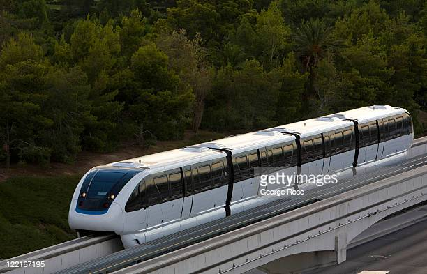Modern monorail train runs along an elevated track between the MGM Grand Hotel and the Las Vegas Convention Center on August 12 in Las Vegas, Nevada....