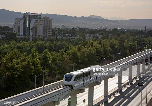 A modern monorail train runs along an elevated track between the MGM Grand Hotel and the Las Vegas Convention Center on August 12 in Las Vegas Nevada...