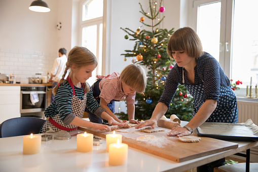 Modern mother making cookies with daughter and son at christmas - gettyimageskorea