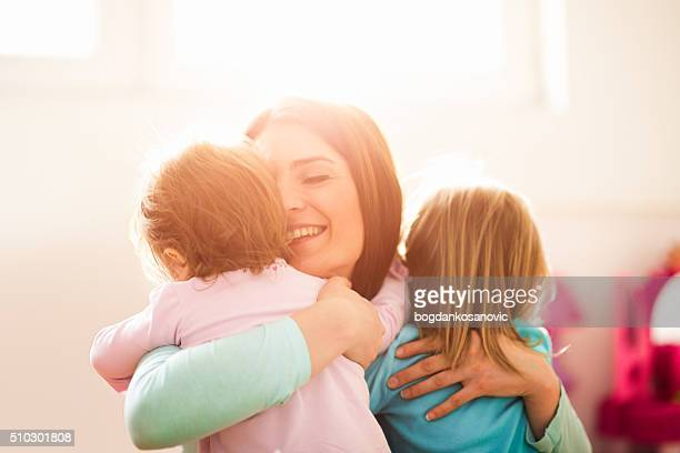 modern mother with daughters - family with two children stock photos and pictures