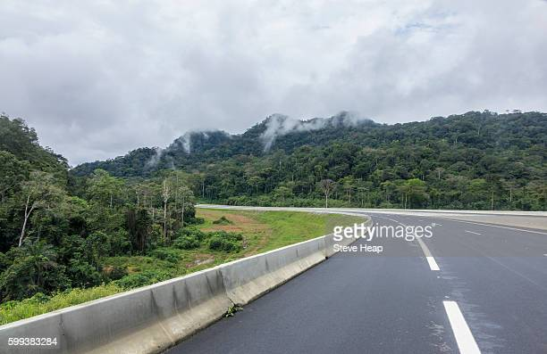 modern motorway between bata and mongomo and the new city of oyala in equatorial guinea - guinea ecuatorial fotografías e imágenes de stock