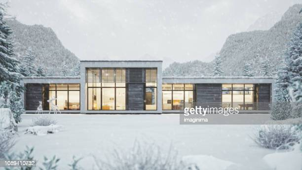 modern mountain house in snowy weather - house stock pictures, royalty-free photos & images
