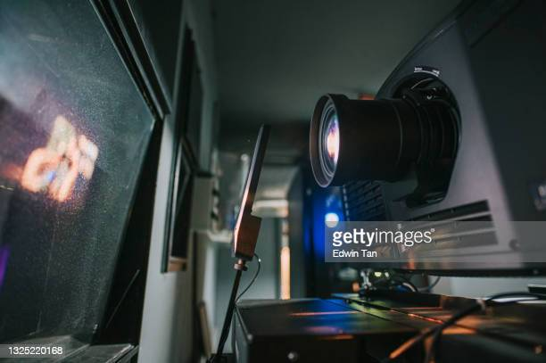 modern movie theater projector room with projector computer digital equipment backstage - film premiere stock pictures, royalty-free photos & images