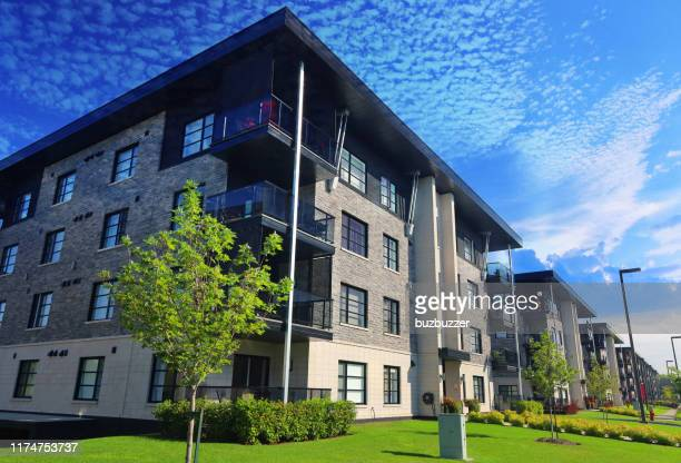 modern multi-condos building blocks - buzbuzzer stock pictures, royalty-free photos & images