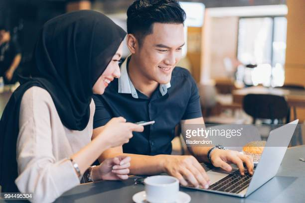 modern muslim couple in cafe - muslim couple stock pictures, royalty-free photos & images