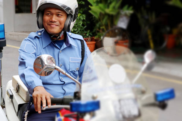 modern muslim - asian policeman stock pictures, royalty-free photos & images