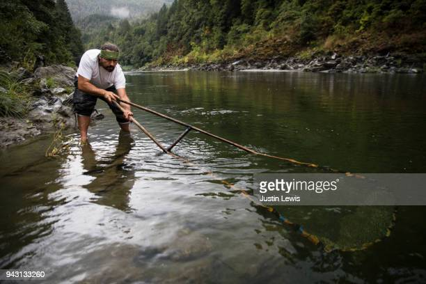 Modern Native American Man Uses Traditional Dip Net to Catch Salmon on Klamath River