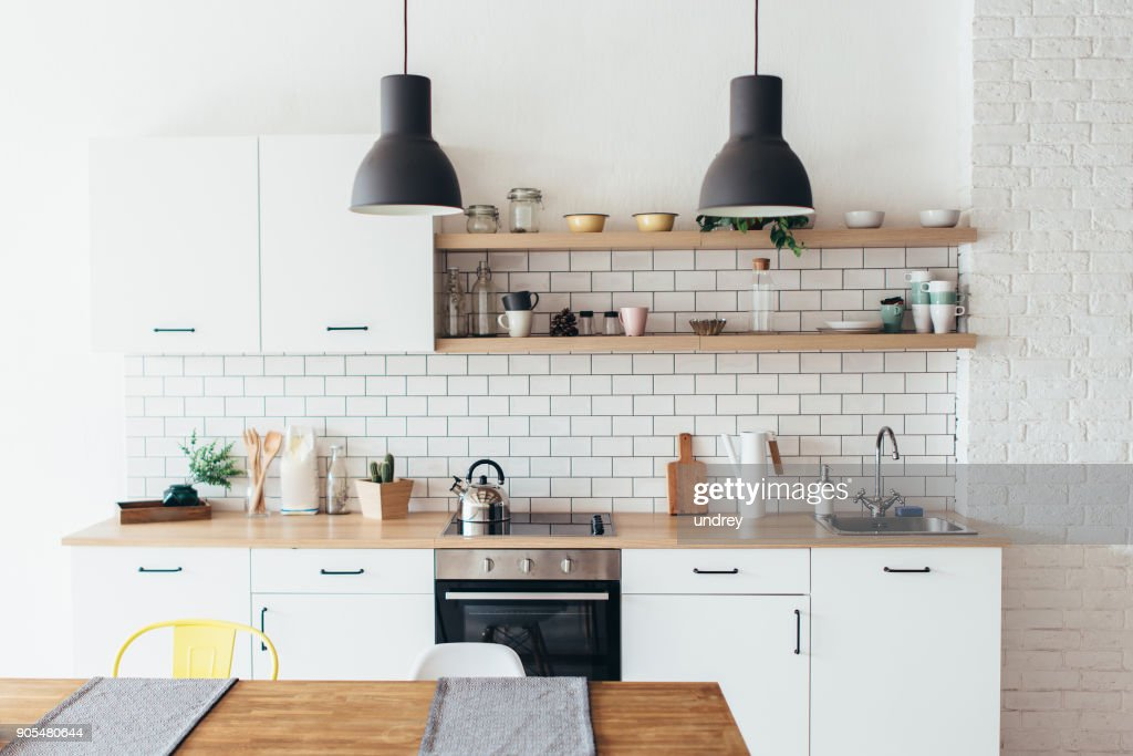 Modern new light interior of kitchen with white furniture and dining table. : Stock Photo
