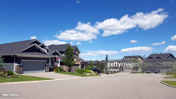 modern north american residential street - calgary stock pictures, royalty-free photos & images