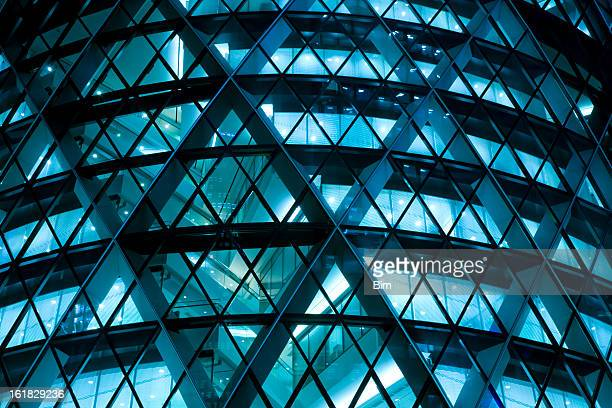 modern office building illuminated at night - downtown stock pictures, royalty-free photos & images