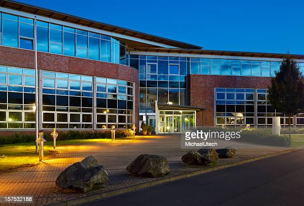 Modern Office Building With Night Blue Sky