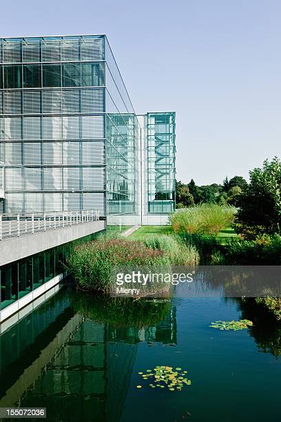 Modern Office Building with Pond in Natural Environment