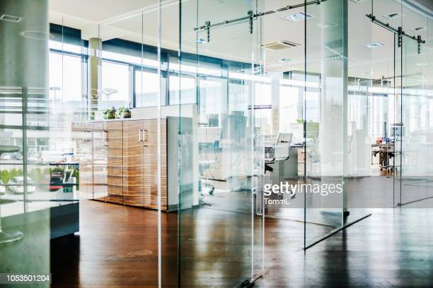 a modern office environment - hotel lobby stock pictures, royalty-free photos & images