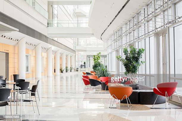 modern office lobby - brightly lit stock pictures, royalty-free photos & images