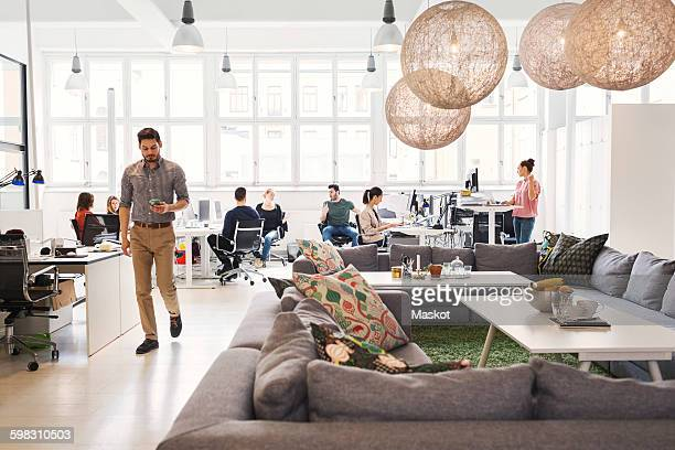 Modern office lobby with business people working in background