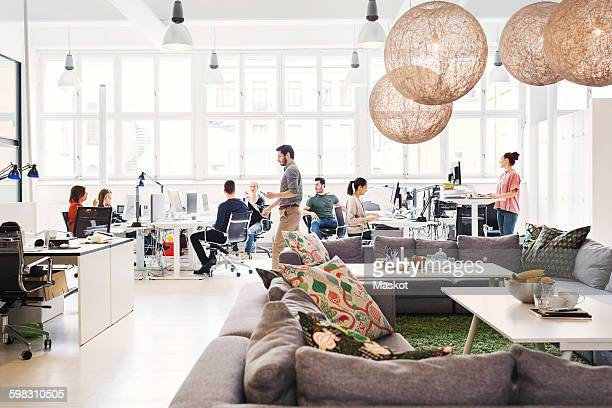 modern office lobby with business people working in background - new business stock pictures, royalty-free photos & images