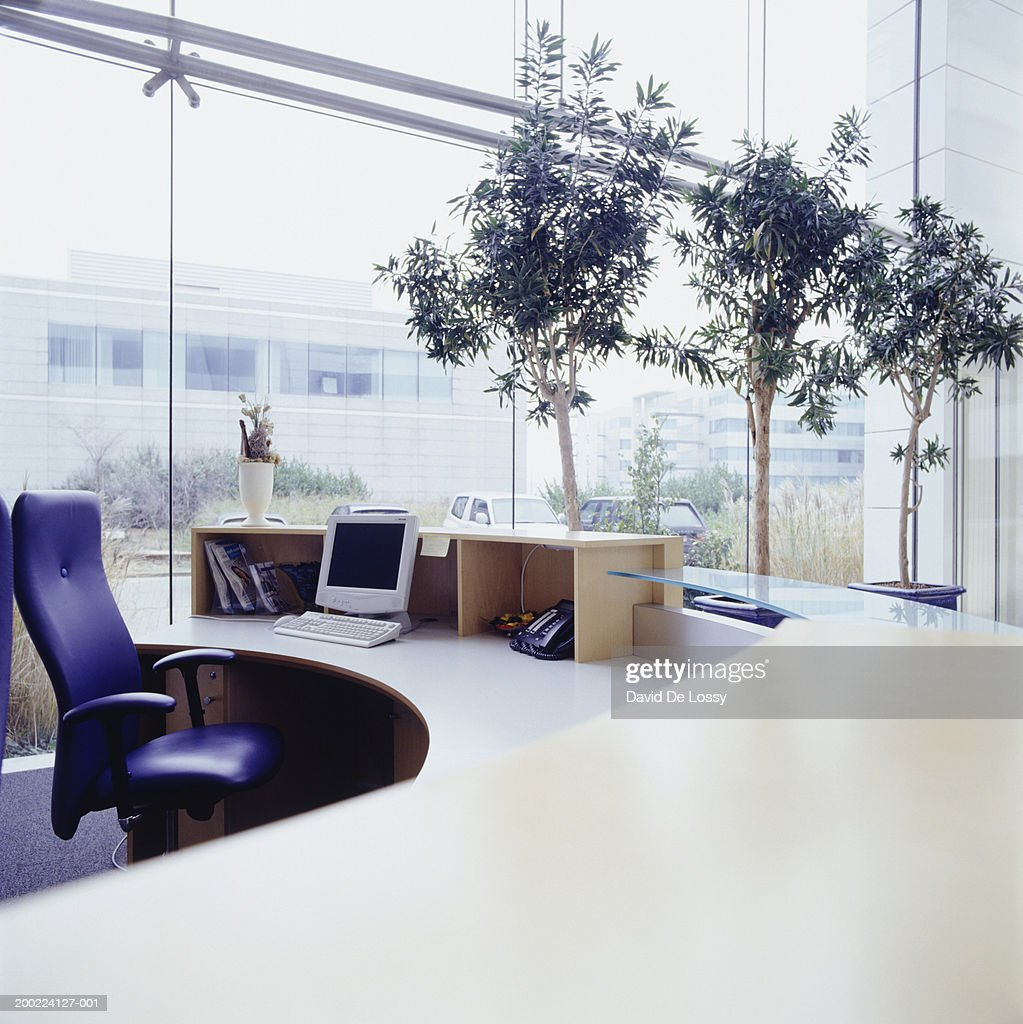Modern office reception desk, interior : Stock Photo