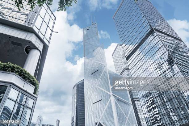 modern office towers in downtown,hong kong - cheung kong centre stock pictures, royalty-free photos & images