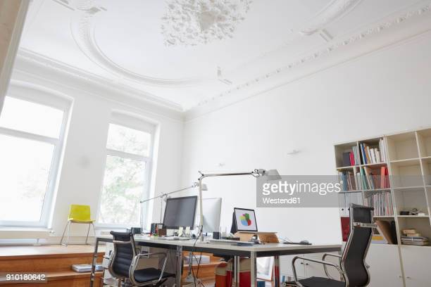 Modern office with stucco ceiling