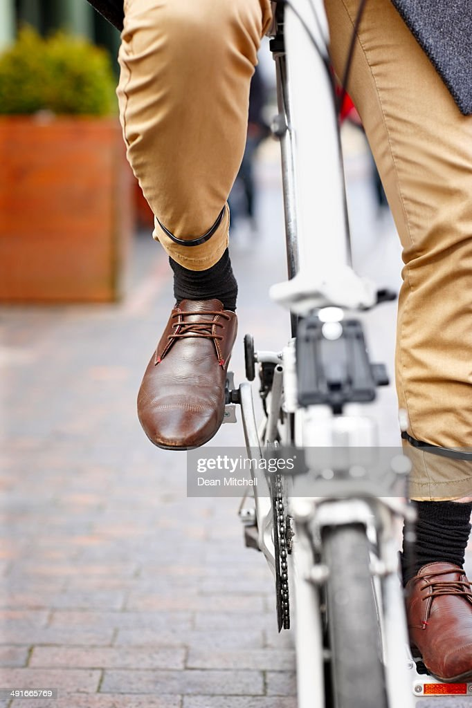 Modern office worker on bicycle : Stock Photo