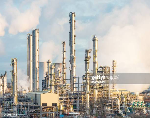modern oil refinery towers - oil refinery stock pictures, royalty-free photos & images