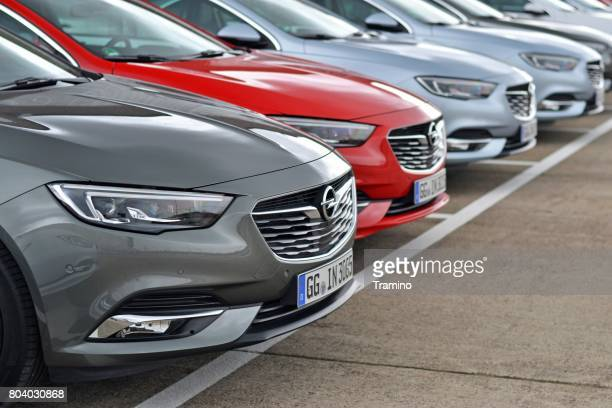 modern opel vehicles on the parking - psa stock photos and pictures