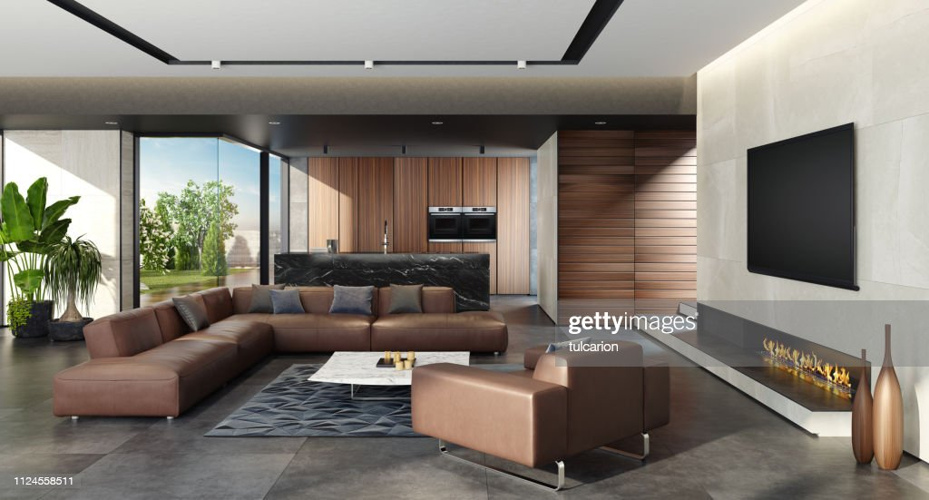 Modern Open Concept Kitchen And Living Room Area With Eco Fireplace High Res Stock Photo Getty Images