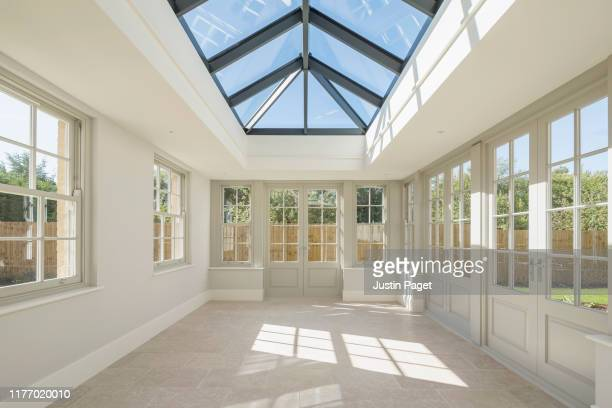 modern orangery in new build house - window stock pictures, royalty-free photos & images