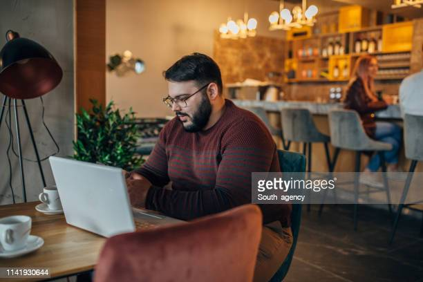 modern overweight man in cafe - fat woman sitting on man stock pictures, royalty-free photos & images