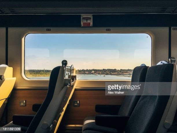 modern passenger train interior with scenic window view - carriage stock pictures, royalty-free photos & images