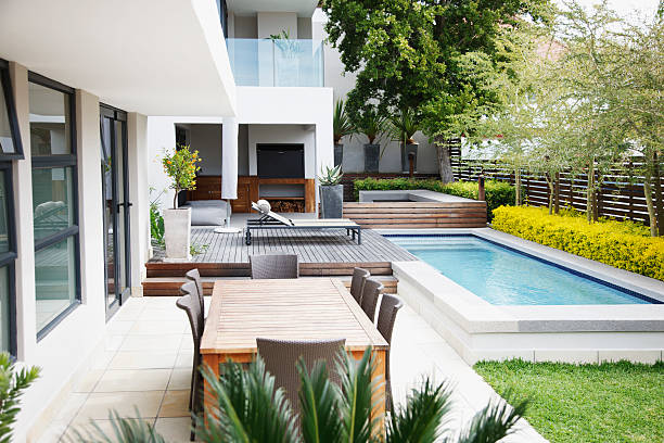 modern patio next to swimming pool - modern stock pictures, royalty-free photos & images