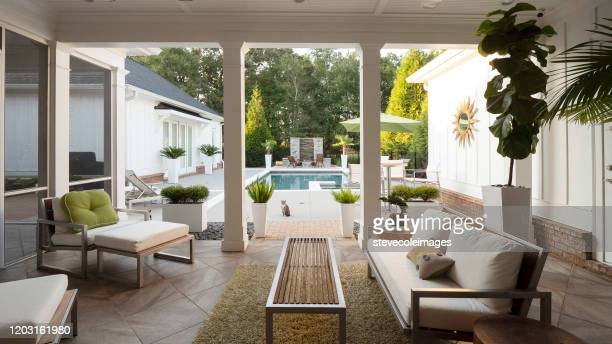 modern patio overlooking pool. - patio stock pictures, royalty-free photos & images