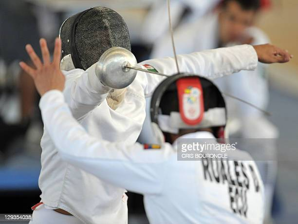 Modern pentathlon athletes Mexican Abraham Camacho and Ecuadorean David Ruales participate in the men's fencing discipline of the Pan American Games...