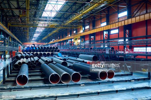 modern pipe-rolling plant with steel tubes - making stock pictures, royalty-free photos & images