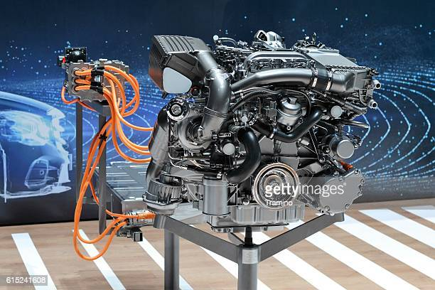 modern plug-in hybrid car engine - hybrid car stock photos and pictures