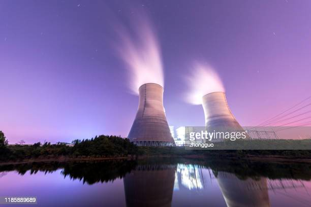 modern powerplant producing heat - atomic imagery stock pictures, royalty-free photos & images