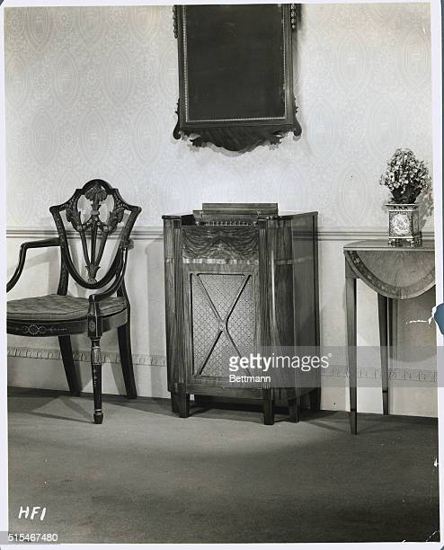 A modern radio console ca 1930's surrounded by classic Federalist furniture Undated photo