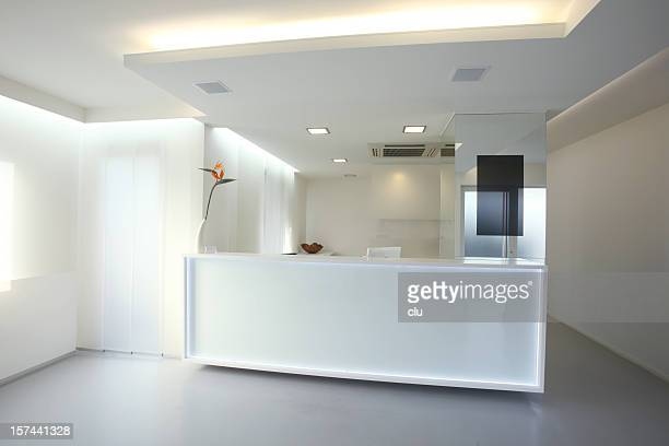 modern reception desk in grey white color (xxxl) - ceiling stock pictures, royalty-free photos & images