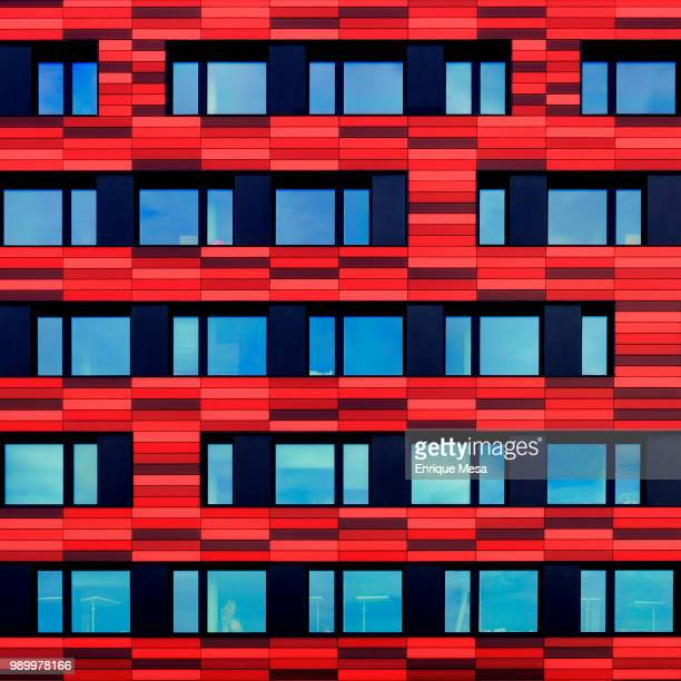 Modern red apartment with rectangular pattern, Berlin, Germany