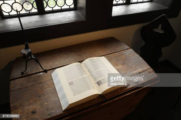 A modern reproduction of Martin Luther's translation into German of the Bible lies on a table at the Lutherhaus museum on May 5 2017 in Eisenach...
