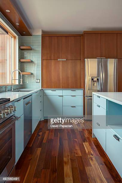 Modern residential kitchen with hardwood floors