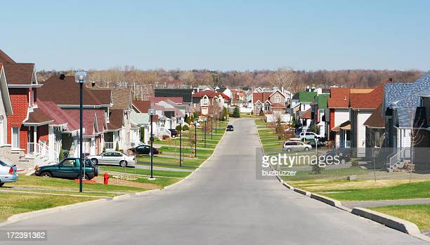 modern residential street - buzbuzzer stock pictures, royalty-free photos & images