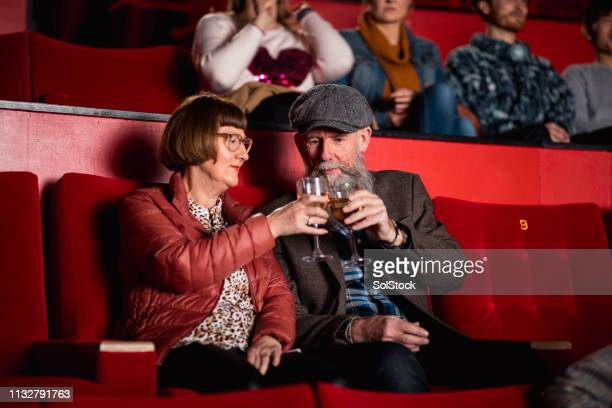 modern seniors in the cinema - film industry stock pictures, royalty-free photos & images
