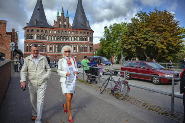 Modern Seniors walking from the Holsten Gate in Lübeck