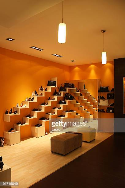 Modern shoe store with orange walls at night