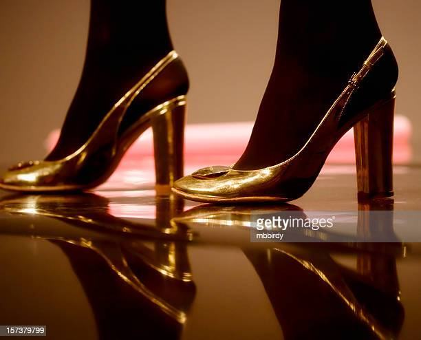 modern shoes - gold shoe stock pictures, royalty-free photos & images