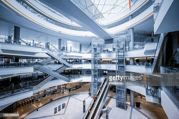 modern shopping mall - shopping centre stock photos and pictures