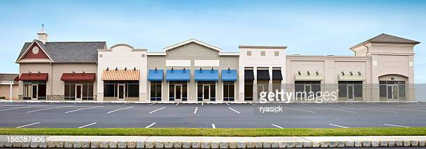modern shopping plaza store front panoramic with empty parking lot - store stock pictures, royalty-free photos & images